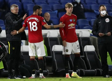 Manchester United's manager Ole Gunnar Solskjaer, left, congratulates Manchester United's Bruno Fernandes as he leaves the pitch.