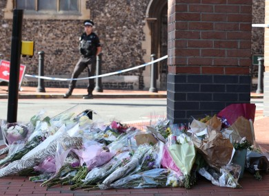 Flowers placed in front of the Post Office in Reading town centre after the attack earlier this month.