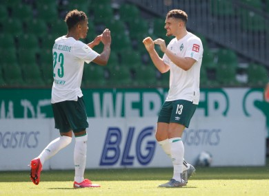 Theodor Gebre Selassie and Milos Veljkovic celebrate a Bremen goal.