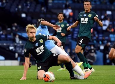 Ben Mee in action against Man City.