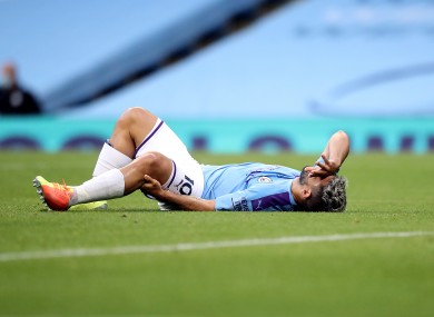 Sergio Aguero holds his knee after sustaining the injury.