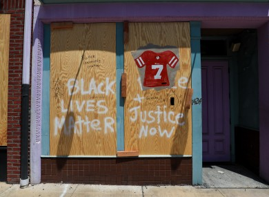 BLM: Colin Kaepernick's jersey is painted on a boarded-up business in downtown Cincinnati.