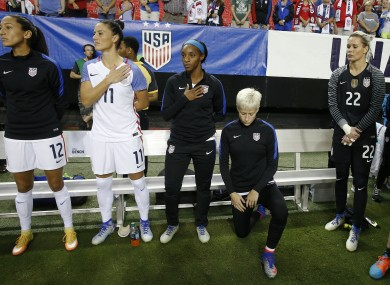 Megan Rapinoe knees next to team-mates before a game between USA and Netherlands in September 2016.