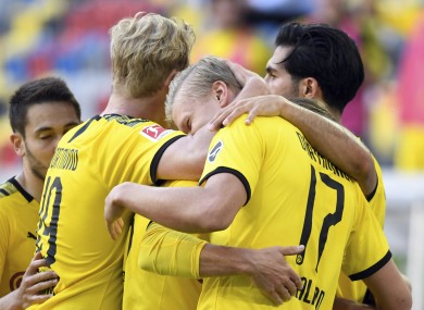 Erling Braut Haaland is congratulated after his late winning goal for Borussia Dortmund this afternoon.