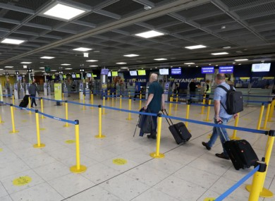 Passengers in Dublin Airport yesterday.