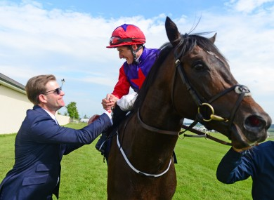 Romanised and jockey Shane Foley are greeted by winning trainer Ken Condon.