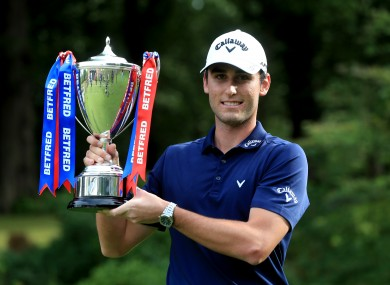 Italy's Renato Paratore celebrates with the British Masters trophy.
