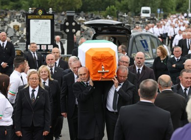 Mourners carry the coffin of former leading IRA figure Bobby Storey