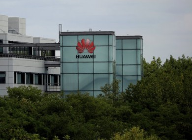 A Huawei sign is displayed on their premises in Reading, England.