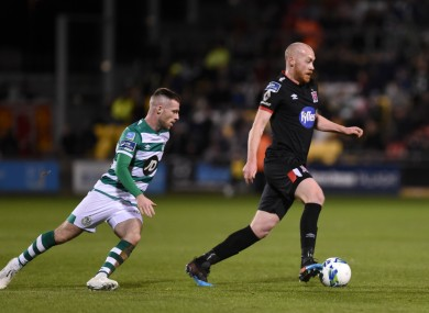 Jack Byrne of Shamrock Rovers with Dundalk's Chris Shields.