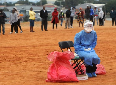 A medical worker waits for a patient in Johannesburg.