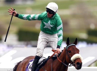 Davy Russell on board Presenting Percy celebrates victory at Cheltenham.
