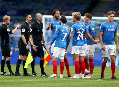 Ronan Curtis and Portsmouth team-mates remonstrate with the officials after their game against Oxford United.