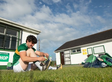 Ronan Corcoran gets ready for training outside the closed dressing rooms at Ballyhale Shamrocks.