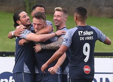 Sligo's Ronan Coughlan celebrates their second goal with team-mates.