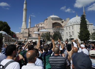People chant slogans following Turkey's Council of State's decision, outside the Byzantine-era Hagia Sophia.