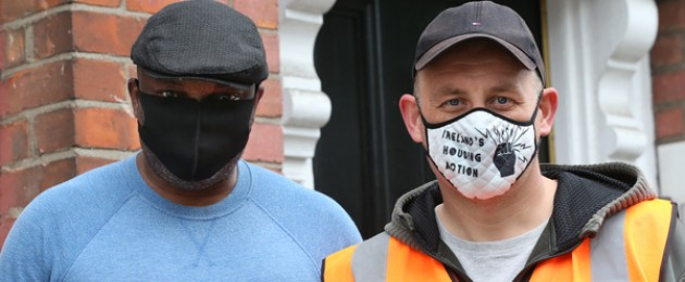 Resident Niyi Jegede and Simon Haslam Ireland's Housing Action group outside the site of an eviction in Dublin.