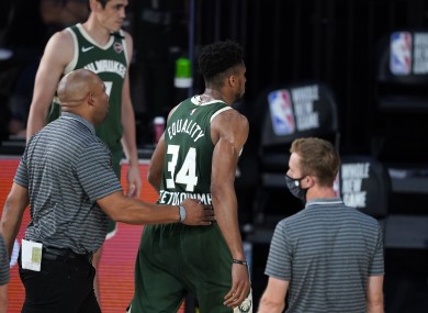Giannis Antetokounmpo heads to the locker room after being ejected from the game.