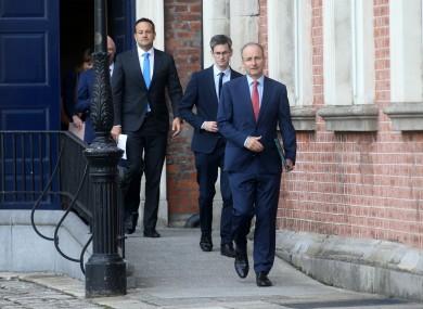 Taoiseach Micheál Martin (right), with acting chief medical officer Dr Ronan Glynn and Tánaiste Leo Varadkar behind him.
