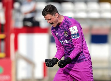 All square: Shels keeper Colin McCabe celebrates Brennan's equaliser.