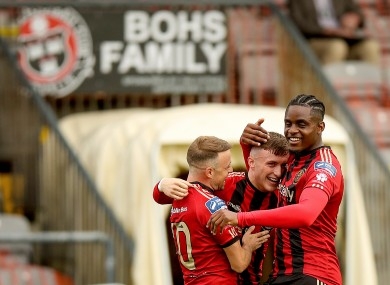 Bohemians' Danny Grant celebrates scoring a goal with Keith Ward and Andre Wright.