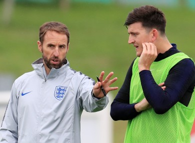 Manager Gareth Southgate pictured with Harry Maguire during an England training session in 2018.