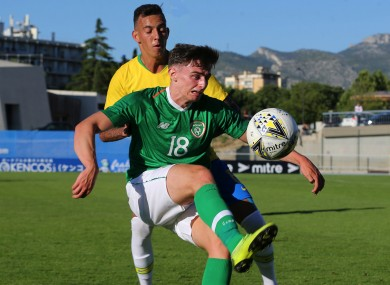 Simon Power under pressure from Iago during the meeting of the U21 teams of Ireland and Brazil in the semi-final of last year's Toulon Tournament.