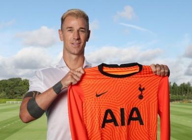 Hart holding up the Spurs shirt.