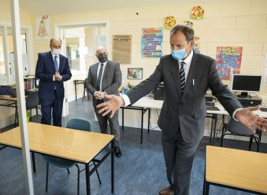 Taoiseach Micheál Martin (left) with Deputy Principal Nicholas O'Keefe and Principal Jim O'Sullivan at Nagle Secondary Community College in Mahon in Cork last week.