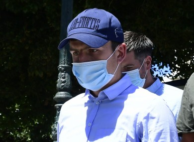 Maguire pictured in Greece as he leaves a court building.