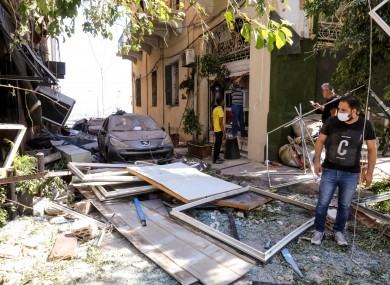 Locals survey the damage in downtown Beirut.
