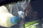 A man is tested for Covid-19 at a drive-through testing centre in Christchurch, New Zealand, today.