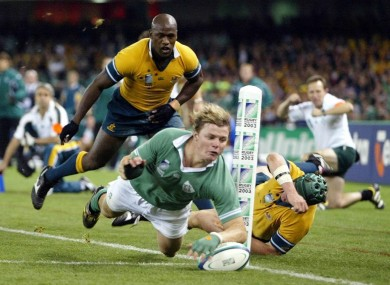 Brian O'Driscoll goes over to score Ireland's try in their 16-15 defeat by Australia at the 2003 tournament in Melbourne.