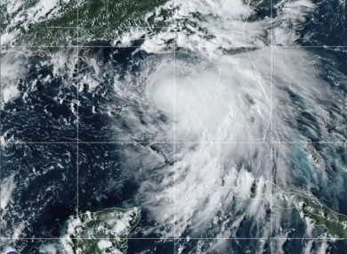 Tropical Storm Sally is shown churning northwards yesterday