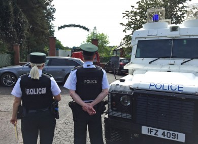Police and army bomb disposal experts at Shandon Park Golf Club in east Belfast to examine a suspect device under a car in the car park in June 2019.