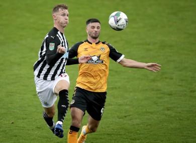 Newcastle United's Emil Krafth is put under pressure by Padraig Amond of Newport County.