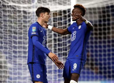 Kai Havertz celebrates with Chelsea team-mate Tammy Abraham after completing his hat-trick against Barnsley.