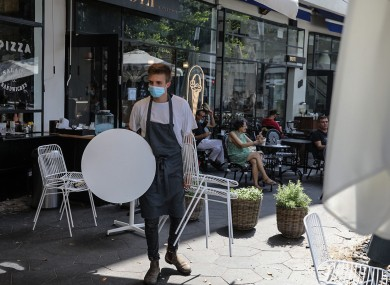 A worker at a Tel Aviv restaurant cleaning up ahead of the fresh lockdown.