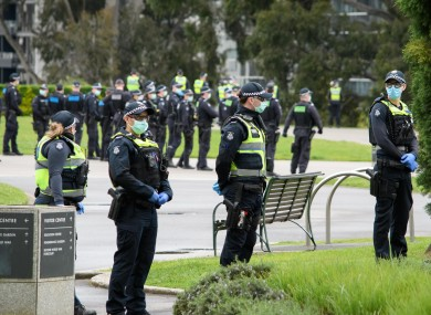 Police on the lookout at a protest against coronavirus regulations in Melbourne, Australia.