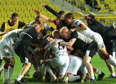 Dundalk's players celebrate last night's win.