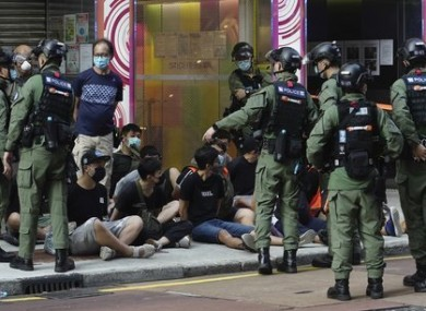 People in Hong Kong are arrested by police officers.