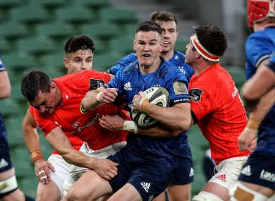 Johnny Sexton of Leinster is tackled by Munster's Tommy O'Donnell and Billy Holland during the sides' recent meeting.