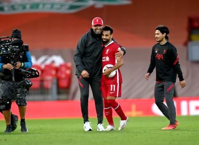 Jurgen Klopp hugs Mo Salah at the final whistle yesterday.