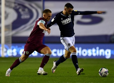Millwall's Troy Parrott under pressure from Josh Benson of Burnley during this evening's Carabao Cup tie.