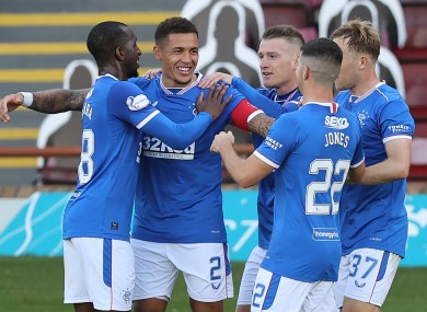 Rangers' James Tavernier (centre left) celebrates with his team-mates after scoring his side's second goal of the game from the penalty spot.
