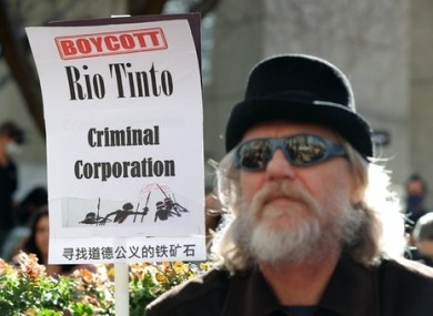 Protesters are seen during a rally outside the Rio Tinto office in Perth in June.