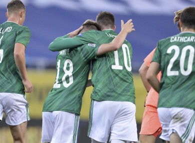 Northern Ireland's Gavin Whyte, second from left, celebrates after scoring.