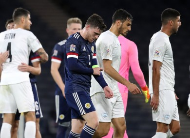 Scotland's Andrew Robertson leaves the pitch at full-time.