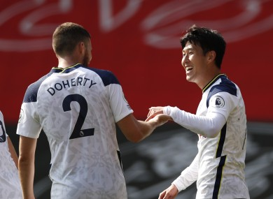 Son Heung-min is congratulated by Matt Doherty after scoring Tottenham's fourth goal against Southampton.