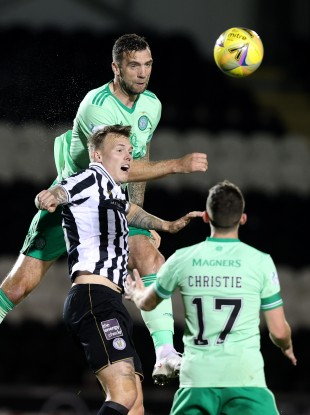 Celtic's Shane Duffy and St Mirren's Lee Erwin battle for the ball.